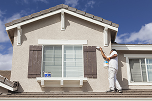 Exterior Painters - Kimberly Painting - Painter on Roof