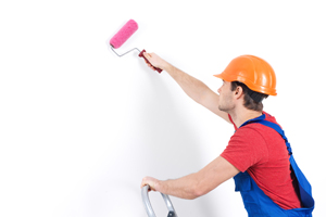 Interior Painters - Kimberly Painting - Painting Contractor Qualities - Man on Ladder with Pink Roller