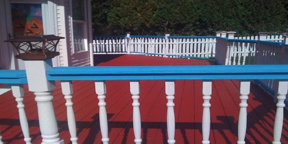 Red Floor Deck Stain with White and Blue Railing - Cumming, GA - Kimberly Painting Contractors