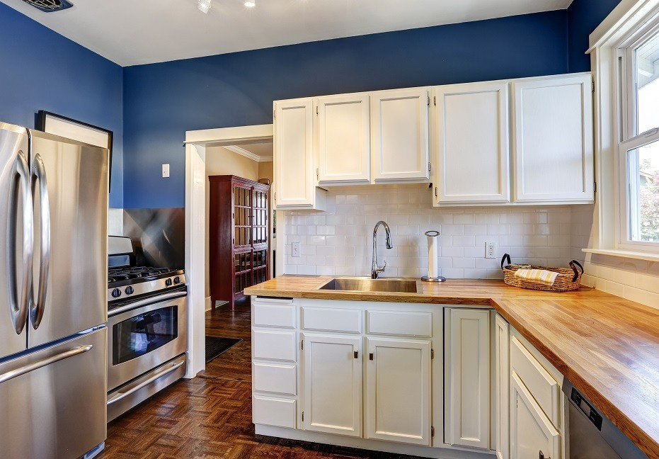 Blue Walls with White Kitchen Cabinet Painting - Cumming, GA - Kimberly Painting Contractors