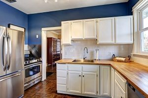 Interior Painting - White Kitchen Cabinets - Blue Paint on Walls - Kimberly Painting Contractors - Cumming, GA 300x200
