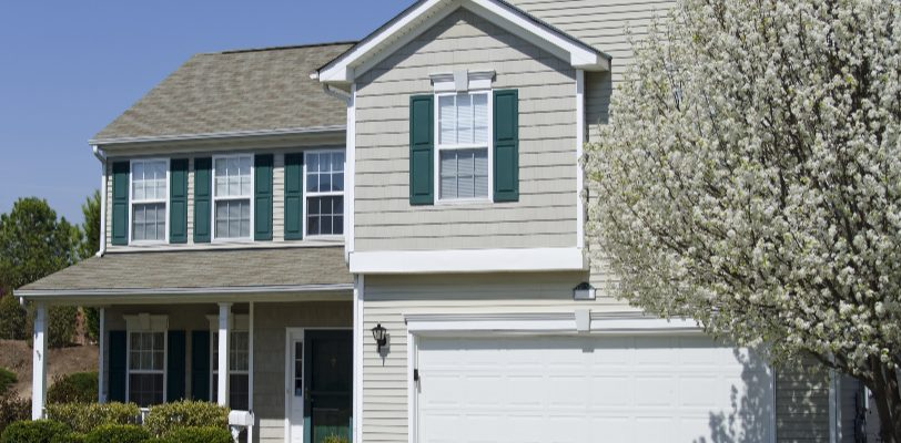 Exterior House Painting Tips - Kimberly Painting - Marietta, GA - Gray two story with green shutters white trim doors
