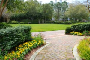 Exterior House Painting Tips - Kimberly Painting - Roswell, GA - Red Paver Driveway with Yellow Flowers Landscaping