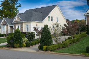 Exterior Painting Tips - Kimberly Painting - Sandy Springs, GA - Yellow house with brick white trim